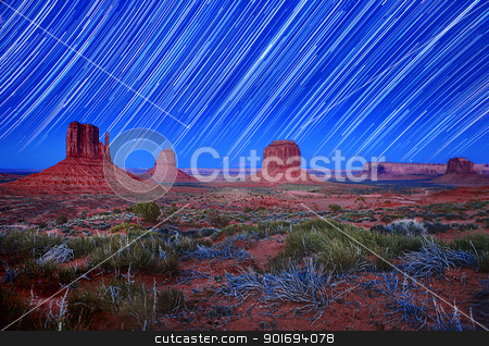 Daylight and Star Trail Image of Monument Valley Arizona USA stock photo, Monument Valley Arizona USA Star Trail Landscape Image. Image Has Slight Grain Due to Conditions. by Katrina Brown