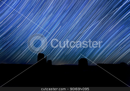 Long Exposure Star Trail Image at Night stock photo, Monument Valley Long Exposure Star Trail Image by Katrina Brown