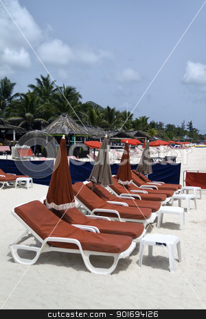 Red Beach Lounge Chairs stock photo, Rows of red several lounge chairs on the beach by Kevin Tietz