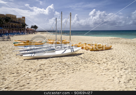 Group of Sail Boats stock photo, A group of personal sail boats on the beach by the ocean by Kevin Tietz