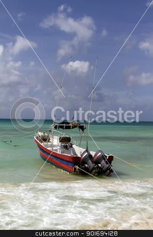 Fishing Boat stock photo, A boat ready to go out to sea by the beach by Kevin Tietz