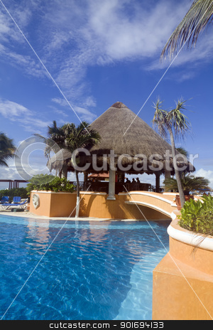 Resort Pool stock photo, A resort pool with blue waters and a bar by Kevin Tietz