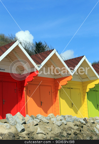 Beach chalets and huts stock photo, Colorful beach chalets and huts with blue sky background and copy space. by Martin Crowdy
