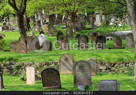 Old gravestones in cemetary stock photo, Scenic view of old gravestones in Victorian cemetary. by Martin Crowdy