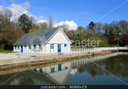 Open air theater on lake stock photo, Dressing room on open air theater reflected on lake in summer with blue sky background, Scarborough, England. by Martin Crowdy