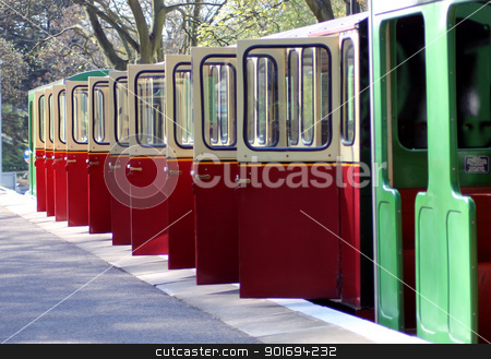 Open railway carriage doors stock photo, Open railway carriage doors of miniature train on platform. by Martin Crowdy