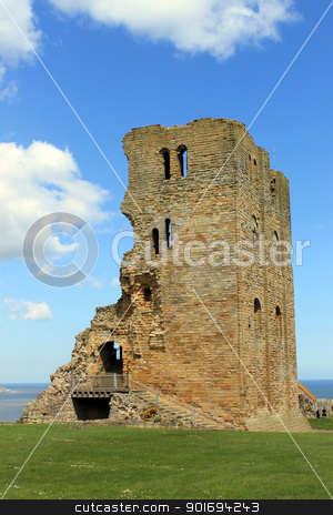 Scarborough Castle ruins1 stock photo, Scenic view of ruins of Scarborough Castle with blue sky and cloudscape background, North Yorkshire, England by Martin Crowdy