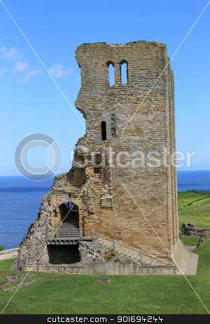 Scarborough Castle ruins stock photo, Scenic view of ruins of Scarborough Castle with blue sky and cloudscape background, North Yorkshire, England. by Martin Crowdy