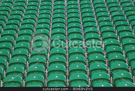Seating in stadium stock photo, Rows of green seats in outdoors stadium or arena. by Martin Crowdy