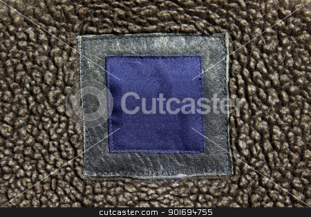 Leather Coat Label stock photo, A blank label on a jacket.  by Chris Hill