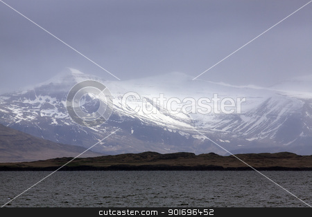 Snowcapped mountains stock photo, Sun shining trough clouds on snowcapped mountains, Iceland by Kjersti Jorgensen