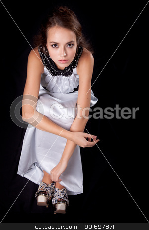 Romantic young woman stock photo, Romantic young caucasian woman on black background by Iryna Rasko