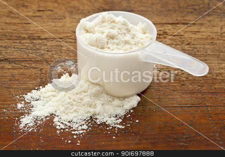 white powder of whey protein stock photo, plastic measuring scoop of white powder (whey protein) against grunge wood background by Marek Uliasz