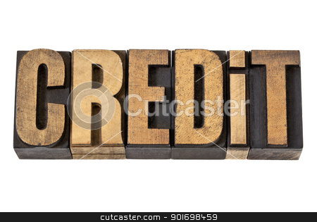 credit word in wood type stock photo, credit - isolated word in vintage letterpress  wood type by Marek Uliasz