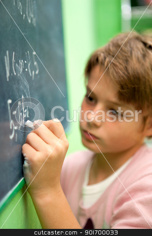 Close up of young student writing on chalkboard stock photo, Close up of young student writing with chalk on chalkboard in classroom by karel noppe
