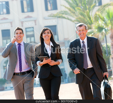 Business colleagues walking outdoors. stock photo, Business colleagues walking outdoors with digital tablet. by karel noppe