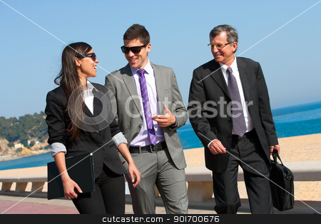 Business team having a walk outdoors. stock photo, Young business couple walking with colleague outdoors. by karel noppe
