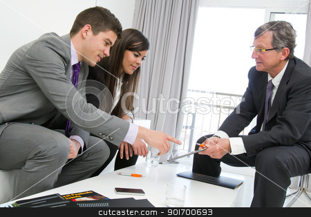 Business threesome at meeting. stock photo, Business threesome at financial meeting with documents and tablet on table. by karel noppe