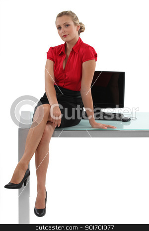 Blond businesswoman sat on desk stock photo, Blond businesswoman sat on desk by photography33