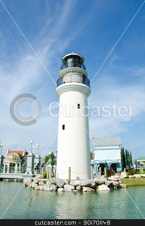 white lighthouse  stock photo, white lighthouse in market near port by chatchai