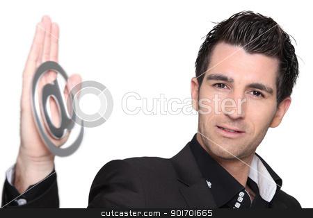 Man holding the at symbol stock photo, Man holding the at symbol by photography33
