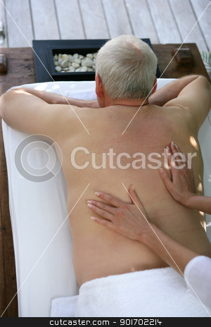 Senior man receiving a back massage stock photo, Senior man receiving a back massage by photography33
