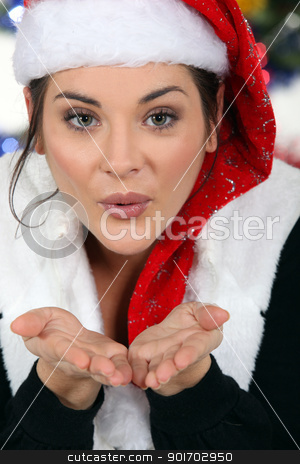 Woman blowing a kiss at Christmas stock photo, Woman blowing a kiss at Christmas by photography33