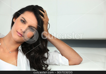 Attractive brunette resting her head in her hands stock photo, Attractive brunette resting her head in her hands by photography33