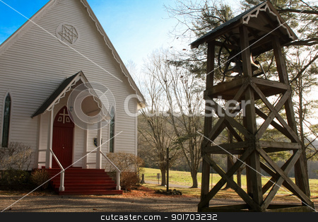 Church with bell in a cemetery stock photo,  by Angela Schmidt