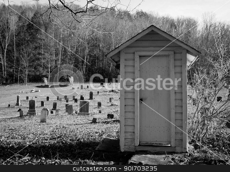 Wooden shed graveyard  stock photo, Wooden shed in graveyard under trees by Angela Schmidt
