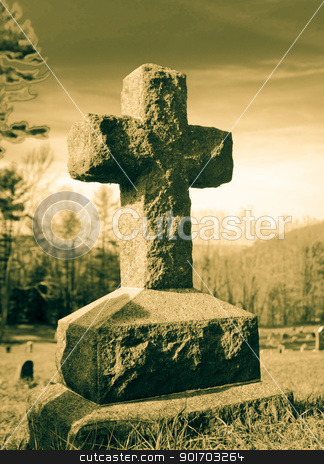 Cross on a hill stock photo, Cross tombstone in a graveyard on a hill by Angela Schmidt