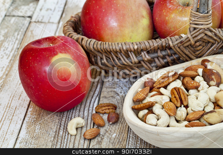 apples and nuts stock photo, red apples and nuts (cashew, walnut, almond, Brazilian) in rustic setting (primitive wooden bowl and wicker basket over grunge painted wood surface) by Marek Uliasz