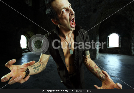 Male vampire attack stock photo, Photo of a male vampire with mouth open and fangs showing.  Harsh lighting and heavily filtered for scarier feel. by © Ron Sumners