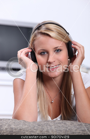 Teenage girl listening to music on headphones stock photo, Teenage girl listening to music on headphones by photography33