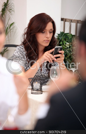 Woman in restaurant looking at mobile stock photo, Woman in restaurant looking at mobile by photography33