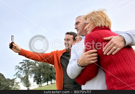 Family taking their own picture with a phone stock photo, Family taking their own picture with a phone by photography33