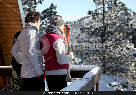 Couple arriving at their winter chalet stock photo, Couple arriving at their winter chalet by photography33