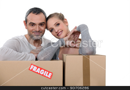 Couple stood with storage boxes stock photo, Couple stood with storage boxes by photography33