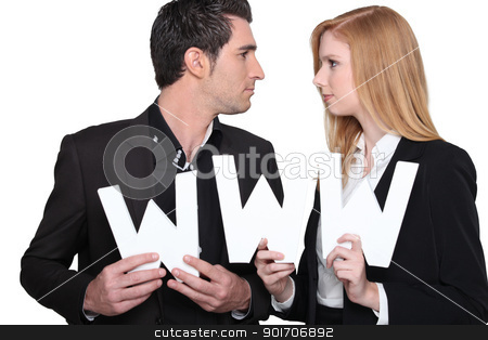 Man and woman in suit carrying www letters stock photo, Man and woman in suit carrying www letters by photography33