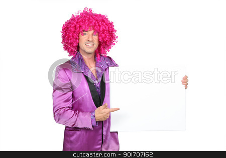 Man in silly seventies costume holding blank board ready for your message stock photo, Man in silly seventies costume holding blank board ready for your message by photography33