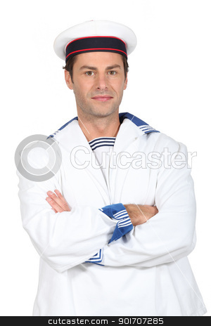 Man in a sailor's costume standing with his arms folded stock photo, Man in a sailor's costume standing with his arms folded by photography33