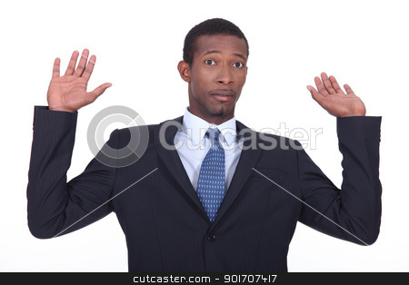 Businessman in a suit holding his hands in the air stock photo, Businessman in a suit holding his hands in the air by photography33