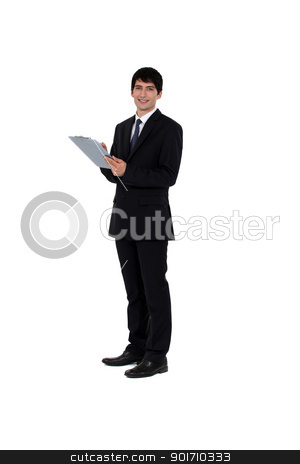 Businessman writing on a clipboard stock photo, Businessman writing on a clipboard by photography33