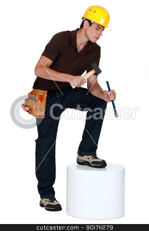 Carpenter with a hammer and chisel stock photo, Carpenter with a hammer and chisel by photography33
