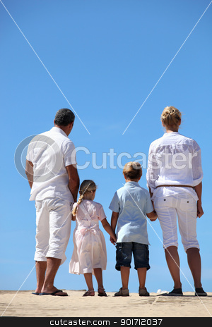 Family at the beach stock photo, Family at the beach by photography33