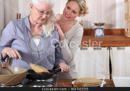 daughter helping her senior mother in the kitchen stock photo, daughter helping her senior mother in the kitchen by photography33