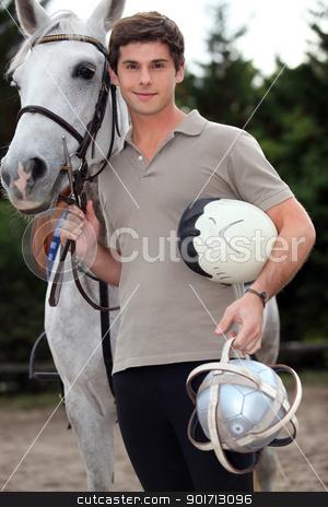 A young horseback rider stock photo, A young horseback rider by photography33