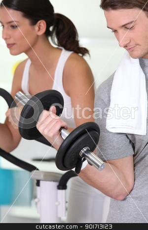 Young people working out in a gym stock photo, Young people working out in a gym by photography33