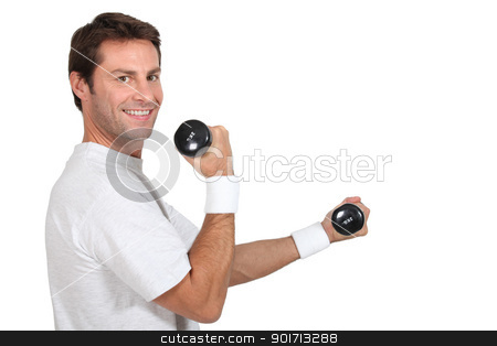 Man working out with hand weights stock photo, Man working out with hand weights by photography33