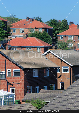 Housing estate stock photo, Modern English housing estate on hillside with rooftops. by Martin Crowdy